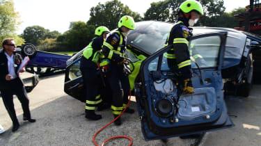 Fire crew road accident preparations door