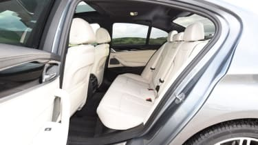 BMW 5 Series - rear seats white leather