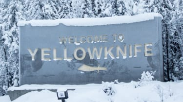 Small town sign snow
