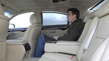 Lexus's rear compartment doesn't have quite as much legroom as S500, but is far better equipped