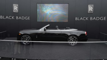 A solid black paint finish and engineering tweaks sets the Rolls-Royce Dawn Black Badge apart from the standard car.