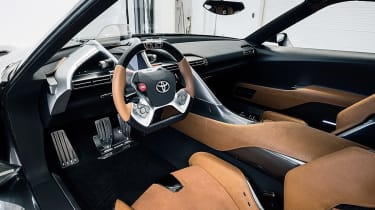 The interior was equally dramatic, featuring a wrap-around dash and centre console, an F1-style steering wheel which housed most of the FT-1's major controls and a digital instrument binnacle.