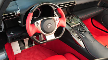 The interior is laced with Carbon Fibre and leather and features electrically operated seats.