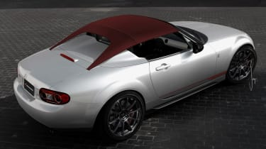 Mazda North America dreamed up a third way for the MX-5's roof arrangement in 2011, fitting it to the MX-5 Spyder concept. The lower-profile canopy stretched over the car was supposed to give a more dynamic look. We just wonder how eas