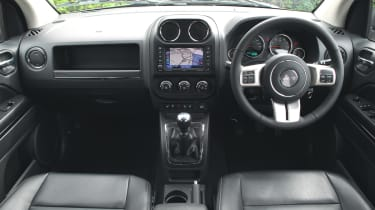 Inside the car has a raised driving position, but the steering wheel does not adjust for reach