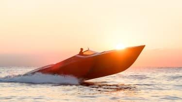 Aston Martin AM37S boat - side sunset