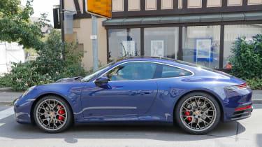 Next generation Porsche 911 outside building