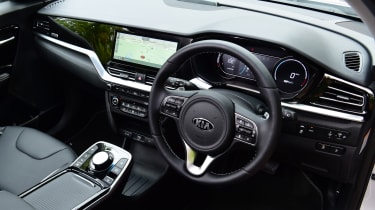 Top-spec 4 versions come with a heated steering wheel and seats, the buttons for which are located next to the drive selector. A lidded storage cubby sits behind it