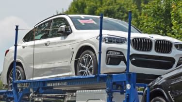New BMW X4 spied uncovered front quarter