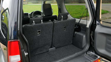 The Jimny's boot is tiny, seats up or down.