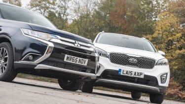 Mitsubishi Outlander vs Kia Sorento static