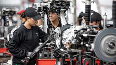 Tesla Factory Tour - fitting brakes
