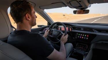 Audi e-tron driving inside