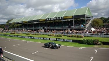 A Sunbeam Tiger blasts past the grandstands on the main straight.