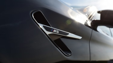 BMW M5 wing badge