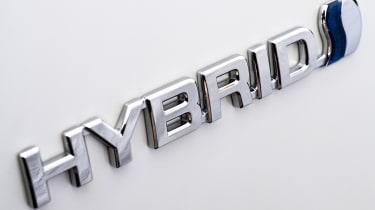 toyota hybrid badge