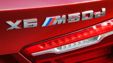 New BMW X6 M50d 2014 badge