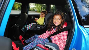 Kids in the back of the MINI 5-door.