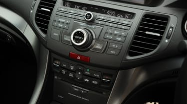 The centre console has far too many buttons compared to more modern cars touchscreen systems.