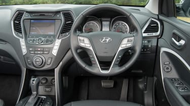 <span>The roomy cabin in the Santa Fe doesn't quite match the quality of its more upmarket rivals.</span>