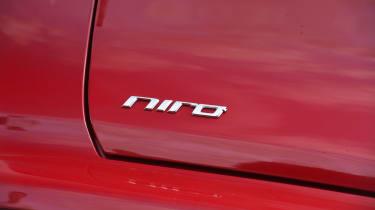 Kia Niro vs Toyota Prius - Kia Niro badge