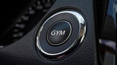 """<p class=""""p1"""">The GYM button disables labour saving gadgets like power steering and increases the force required to operate the pedals and gearbox. Suddenly your drive to work becomes a blood vessel bursting workout capable of burning"""