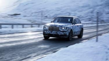 Rolls Royce Cullinan front side snow