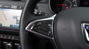 Dacia Duster - steering wheel controls