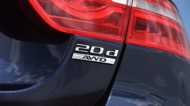 Jaguar XE AWD - badge
