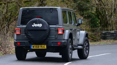 Jeep Wrangler driving rear