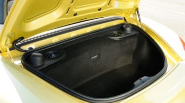 Two small boots give the Boxster decent practicality.