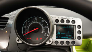 The interior has a motorbike-style pod mounted above steering wheel to hold the speedometer.