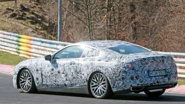 2018 BMW M8 spy shot rear quarter