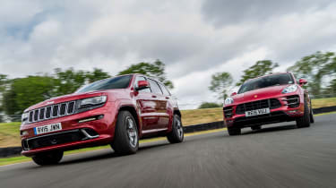 Porsche Macan Turbo and Jeep Grand Cherokee - front cornering