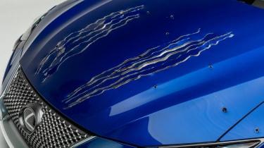 Petersen Automotive Museum  - Lexus RC 500 f sport Black Panther - claw marks