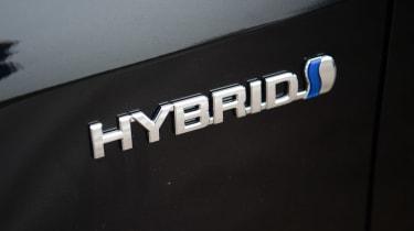 Suzuki Swace - Hybrid badge