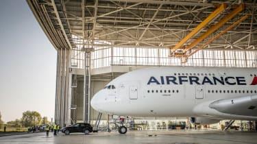 Porsche Cayenne pulls Airbus A380 - side hangar
