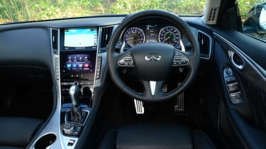 The interior betrays Infiniti's link with Nissan with some old switchgear hanging around.