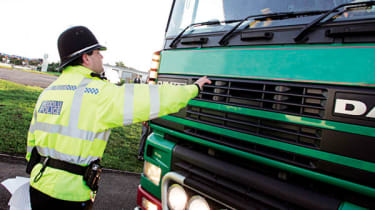 Policeman and lorry