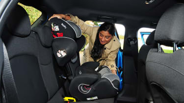 Fitting a child seat in the new MINI 5-door.