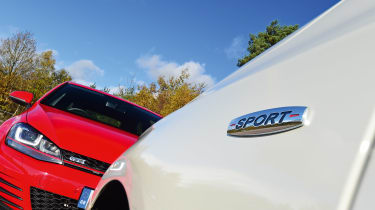 Mercedes A 250 AMG vs Volkswagen Golf GTI - badges