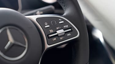 Mercedes steering wheel cruise control buttons