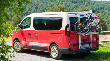 Red Nissan campervan