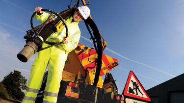 Chris Ebbs repairs a big ol' pothole