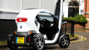 The Twizy is a tiny electric vehicle that sits somewhere in between a scooter and a city car.