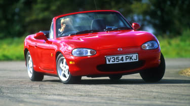 The second generation MX-5 was launched at the 1997 Tokyo Motor Show with the tough task of improving on the original car's 400,000 global sales. The pop-up headlamps bit the dust and the car grew slightly but the MX-5's winning formul