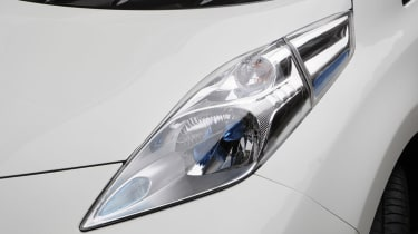 """<p class=""""p1"""">The fared-in nose, sculpted headlamps and distinctive blue badging help the Leaf stand out from traditional family hatchbacks.</p>"""