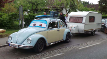 VW Beetle towing a caravan