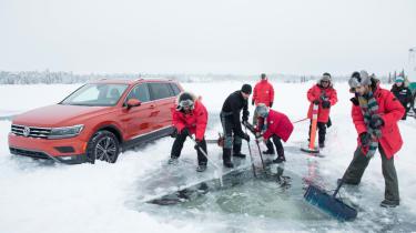 Volkswagen Tiguan  and group frozen lake