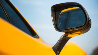 The McLaren's electric motors will drive the car alone for around seven miles before they run out of charge.